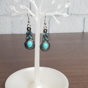 Bohemian silver earrings with a turquoise